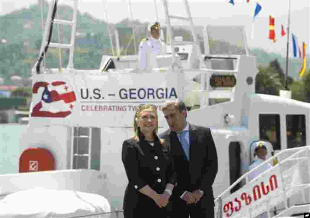 US Secretary of State Hillary Rodham Clinton and Georgian Prime Minister Nika Gilauri attend a Coast Guard ship commissioning ceremony at the passenger terminal wharf in Batumi, Georgia Tuesday June 5 2012. The Soviet-designed boat, which will patrol the