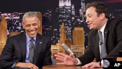 """President Barack Obama (L) laughs while listening to host Jimmy Fallon on the set of the """"The Tonight Show Starring Jimmy Fallon,"""" at NBC Studios in New York, June 8, 2016."""