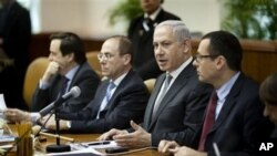 Israeli Prime Minister Benjamin Netanyahu, second right, at the weekly Cabinet meeting in Jerusalem, March 6, 2011