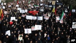 Iranian protesters chant slogans at a rally in Tehran, Iran, Dec. 30, 2017.