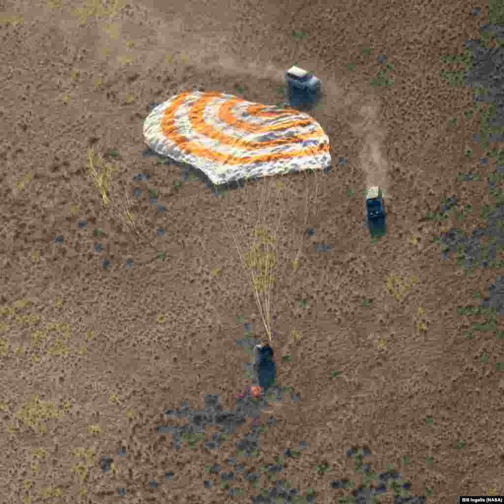 The Soyuz MS-12 spacecraft is seen as it lands in a remote area near the town of Zhezkazgan, Kazakhstan, with Expedition 60 crew members Nick Hague of NASA and Alexey Ovchinin of Roscosmos, along with visiting astronaut Hazzaa Ali Almansoori of the United Arab Emirates.