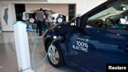 FILE - An electric car is displayed in Tel Aviv, Oct. 10, 2012.