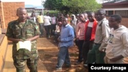 Volunteers queue for new non-surgical male circumcision procedure in Rwanda. (Courtesy Rwandan Dept. of Defense)