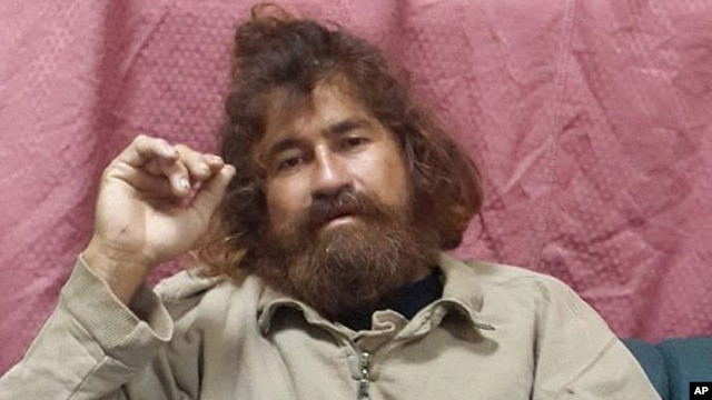 Jose Salvador Alvarenga sits on a couch in Majuro in the Marshall Islands, after he was rescued from being washed ashore on the tiny atoll of Ebon in the Pacific Ocean, Feb. 3, 2014.