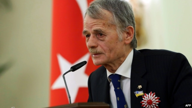"FILE - Prominent Crimean Turkish Tatar political leader and member of the Ukrainian parliament Mustafa Dzhemilev, aka ""Kirimoglu"", delivers a speech after receiving Turkey's Order of The Republic by the Turkish president during a ceremony in Ankara, April 15, 2014."