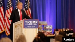 Republican U.S. presidential candidate Donald Trump speaks in front of a display of Trump water, wine and steaks as he talks about the results of the Michigan, Mississippi and other primary elections during a news conference held at his Trump National Club in Jupiter, Florida, March 8, 2016.