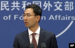 FILE - Chinese Foreign Ministry spokesperson Geng Shuang speaks during a press briefing in Beijing, July 11, 2017, in this image made from video.