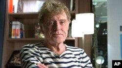 Tài tử và nhà hoạt động về môi trường người Mỹ Robert Redford trả lời phỏng vấn của AP tạI Paris, Pháp, ngày 5/12/2015.