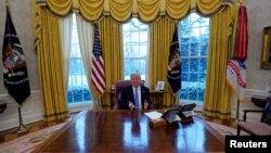 Pirezidaanti Tiraampitti White House keessatti Rooytersiin wal haasahuutit jria.Ammaji 17,2018.