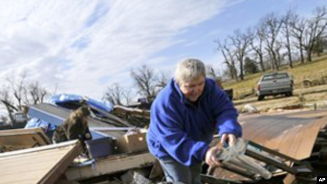 Margie Sisemore cleans after a tornado destroyed several homes in the small town of Cincinnati, Arkansas. That tornado was among 1,600 that crisscrossed the US in 2011.