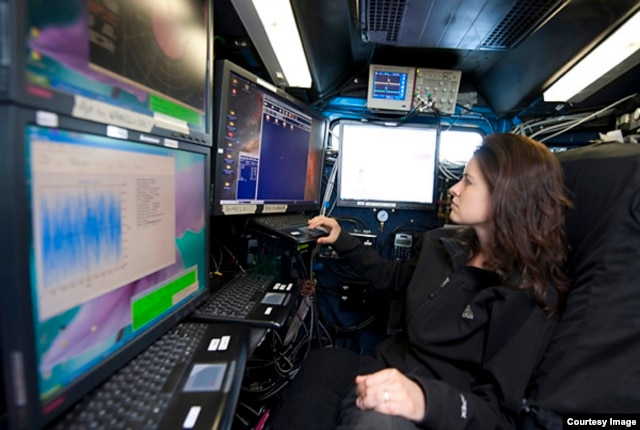 Dr. Karen Kosiba monitors the status of the radar in preparation for the day's scientific mission. (Photo by Jim Reed)