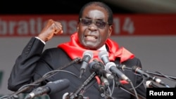 FILE: Zimbabwe President Robert Mugabe addresses supporters during celebrations to mark his 90th birthday in Marondera about 80km ( 50 miles) east of the capital Harare, Feb. 23, 2014. Mugabe turned 90 on February 21.