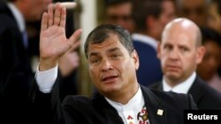 FILE - Ecuador's President Rafael Correa waves as he arrives for the taking office ceremony of Argentina's President Mauricio Macri at Casa Rosada Presidential Palace in Buenos Aires, Argentina, Dec.10, 2015.