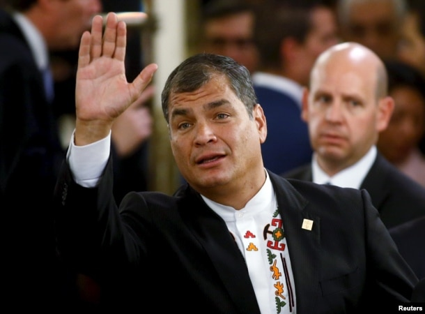 FILE - Ecuador's President Rafael Correa waves prior to a governmental ceremony in Buenos Aires, Argentina, Dec. 10, 2015. Correa recently expressed admiration for Hillary Clinton and said he hoped she wins the U.S. presidential election.