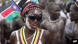 A tribeswoman takes part in Independence Day celebrations in Juba, now the capital of South Sudan, July 9, 2011