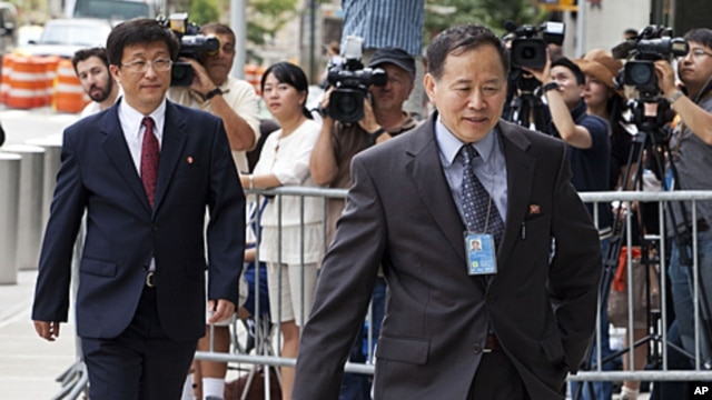 North Korean diplomats return to the Ronald H. Brown United States Mission to the United Nations, July 28, 2011, in New York