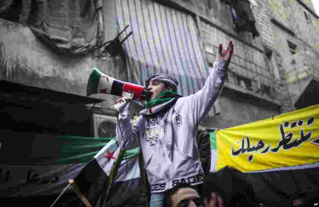 A child uses a megaphone to lead others in chanting Free Syrian Army slogans during a demonstration in Bustan Al-Qasr, Aleppo, Syria, January 4, 2013.