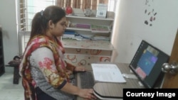 Working lady on computer at Narinibash.