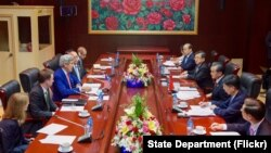 U.S. Secretary of State John Kerry addresses Chinese Foreign Minister Wang Yi and his delegation at the National Convention Center in Vientiane, Laos, on July 25, 2016, during the outset of a bilateral meeting on the sidelines the annual meeting of the ASEAN meeting.
