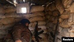 Pripadnik pobunjenika u bunkeru u blizini provincije Alepo, 30. decembar 2016.