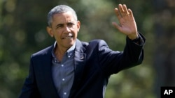 President Barack Obama waves as he walks on the South Lawn of the White House in Washington, Sept. 7, 2015.