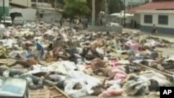 Bodies from the Haitian earthquake can be seen on the side of the road in Port-au-Prince