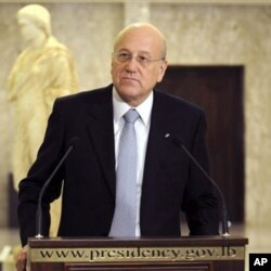Lebanese Prime Minister designate Najib Mikati speaks during a press conference at the presidential palace in Baabda, east of Beirut, Lebanon, Jan. 25, 2011
