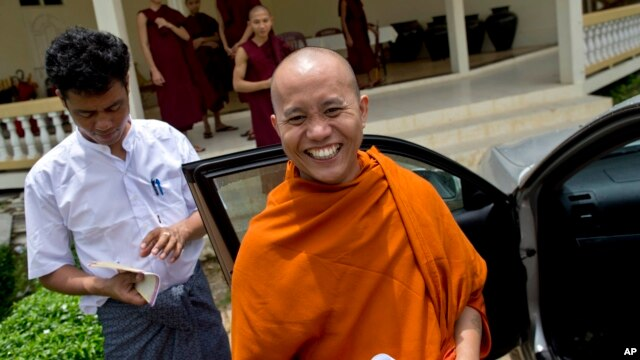 Controversial Buddhist monk Wirathu, foreground, June 14, 2013.