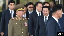 North Korean Hwang Pyong-So (2L), director of the military's General Political Bureau, the top military post in North Korea, walks with other officials as they leave a meeting with South Korean Unification Minister Ryoo Kihl-Jae, on the sidelines of the ongoing Asian Games, Oct. 4, 2014.