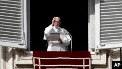 Pope Francis delivers a blessing during the Angelus noon prayer in St. Peter's Square, at the Vatican, Nov. 26, 2017.