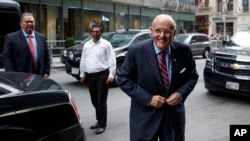 FILE - Former New York mayor Rudy Giuliani arrives at Trump Tower.