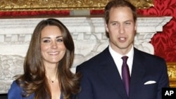 Britain's Prince William and his fiancee Kate Middleton pose for a photograph in St. James's Palace in central London, November 17, 2011