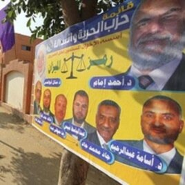 "A poster by Egypt's Muslim Brotherhood ""The Freedom and Justice Party'"" outside a polling station in Cairo, November 28, 2011."