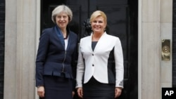 Britain's Prime Minister Theresa May, left, welcomes President Kolinda Grabar-Kitarovic of Croatia to No 10 Downing Street in London, Oct. 11, 2016.
