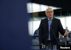 "FILE - European Commission President Jean-Claude Juncker delivers a speech during a debate on the future of Europe at the European Parliament in Strasbourg, France, May 30, 2018. Juncker on May 31 called U.S. tariffs on steel and aluminum imports ""unjustified."""