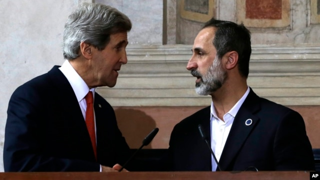 U.S. Secretary of State John Kerry shakes hands with Syrian National Coalition President Mouaz al-Khatib, after a news conference at Villa Madama in Rome, February 28, 2013.