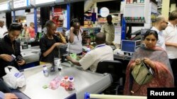 People shop at a Nakumatt store in an upmarket area of Nairobi, Kenya, Jan. 5, 2011.