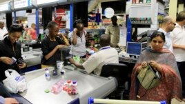 People shop at a Nakumatt store in an upmarket area of Nairobi, Kenya, Jan. 5, 2011.