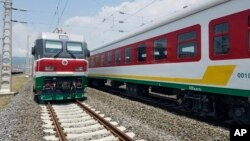 FILE - Locomotives for the new Ethiopia to Djibouti electric railway system queue outside a train station in the outskirts of Addis Ababa, Sept. 24, 2016.