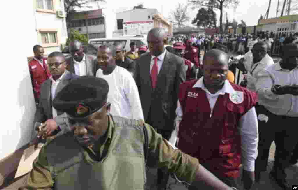 Nigerian comedian Baba Suwe, whose real name is Babatunde Omidina, center, arrive for court hearing at a Federal High Court in Lagos, Nigeria, Tuesday, Nov. 1, 2011. The court on Friday ordered authorities to free the popular actor who has been held for m