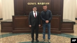 A Dec. 5, 2018, photo, made available by Turkish presidential adviser Yasin Aktay, shows him, left, with American actor-director Sean Penn, in Ankara, Turkey.