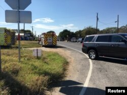 Fire trucks are seen near a Baptist church in Sutherland Springs, Texas, Nov. 5, 2017, in a picture obtained via social media. (MAX MASSEY/KSAT 12)