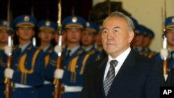 FILE - Kazakstan's President Nursaltan Nazarbaev is shown during a welcoming ceremony in the Great Hall of the People, Beijing, China, Dec. 23, 2002.