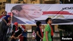 3일 이집트 카이로에서 압델 파타 엘시시 당선자의 지지자들이 대통령 선거 승리를 축하하고 있다.