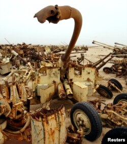 FILE - A destroyed anti-aircraft gun lies in a scrapyard in the Kuwait desert containing the remnants of an Iraqi army destroyed by coalition forces during the Gulf War. Nov. 5, 2002.