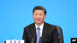 FILE - Chinese President Xi Jinping delivers a speech in Beijing, July 6, 2021, in this photo released by Xinhua News Agency.