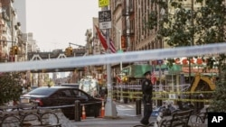 New York Police Department officers investigate at the scene of an attack in Manhattan's Chinatown neighborhood, Oct. 5, 2019 in New York.