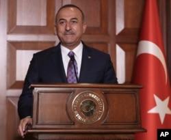 Turkish Foreign Minister Mevlut Cavusoglu speaks to journalists, in Ankara, Turkey, Sept. 10, 2019.