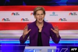 Democratic presidential hopeful Massachusetts Senator Elizabeth Warren participates in the first Democratic primary debate of the 2020 presidential campaign at the Adrienne Arsht Center for the Performing Arts in Miami, June 26, 2019.