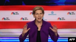 FILE - Democratic presidential hopeful Massachusetts Senator Elizabeth Warren participates in the first Democratic primary debate of the 2020 presidential campaign at the Adrienne Arsht Center for the Performing Arts in Miami, June 26, 2019.